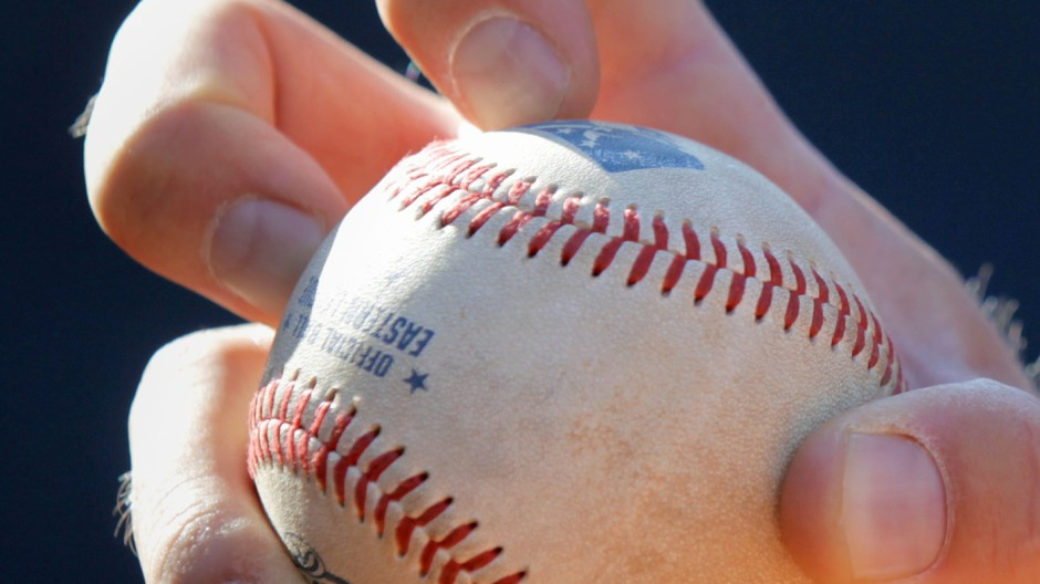 The knuckleball grip used by Boston Red Sox pitcher Steven Wright. Good fingernails are important.